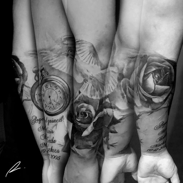 Black and grey timepiece and roses forearm piece
