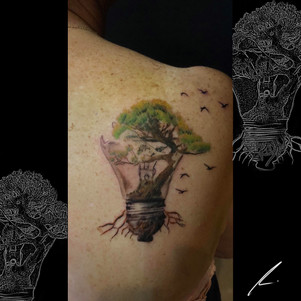 Lightbulb with tree color realism