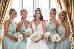 Could these bridesmaid's posies complement the bride any better??