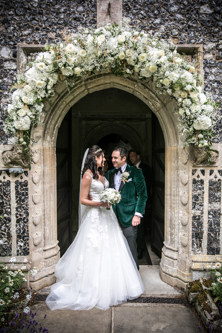 Just married! A floral arch this beautiful sets the scene for a magical day.