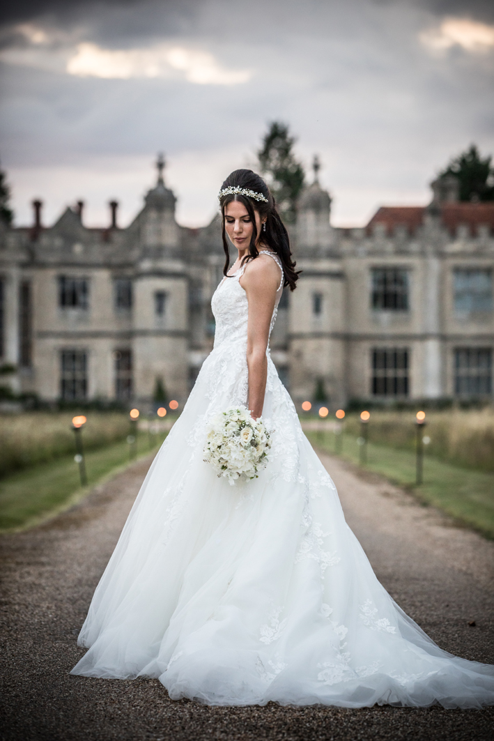 The beautiful white wedding bouquet looks sensational against Rachel's fabulous dress.