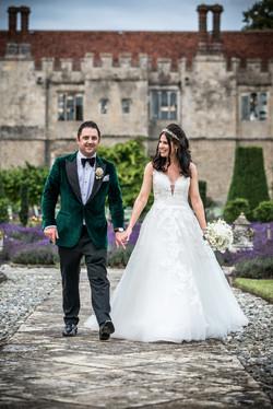 Exquisite white bridal bouquet and groom's buttonhole set against the lavender.