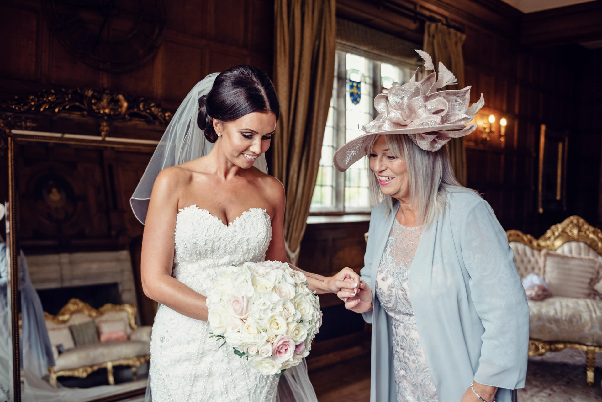 The Mother of the Bride marvels at Jayde's sensational bouquet.