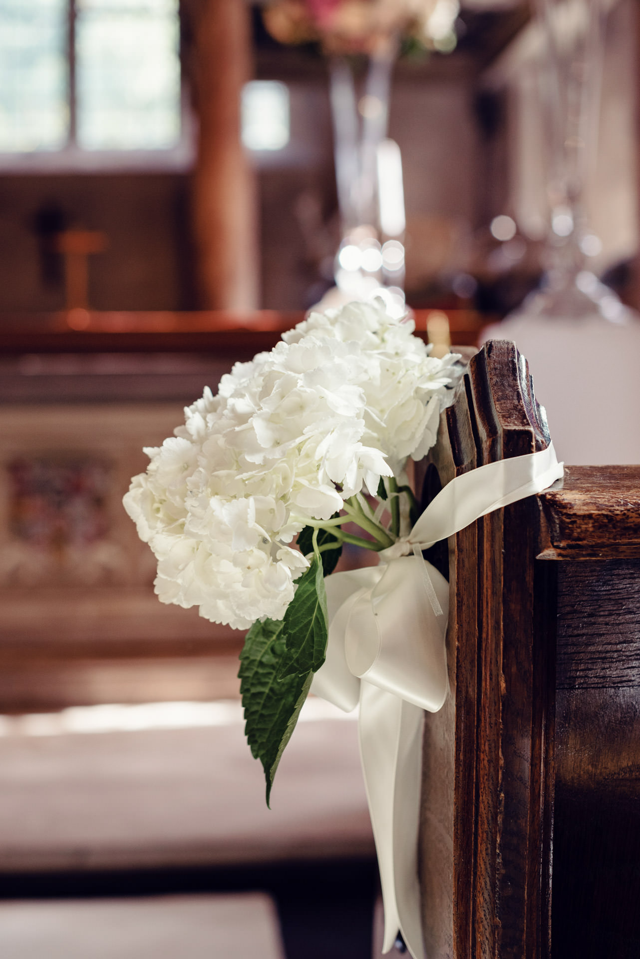 Simple Hydrangea posies with ivory ribbon - simple pew ends.