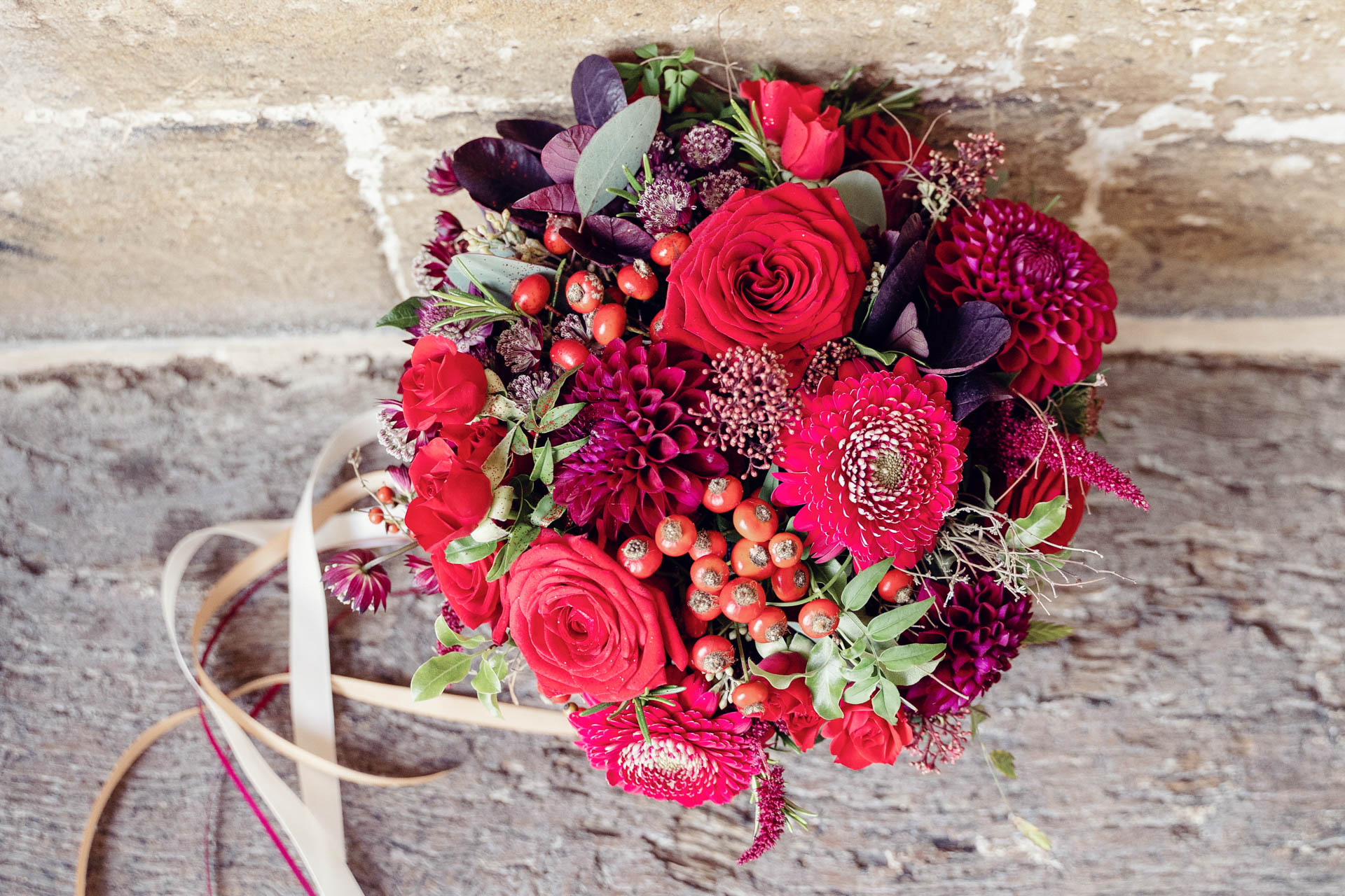Lizzy's deep red bouquet oozes passion.
