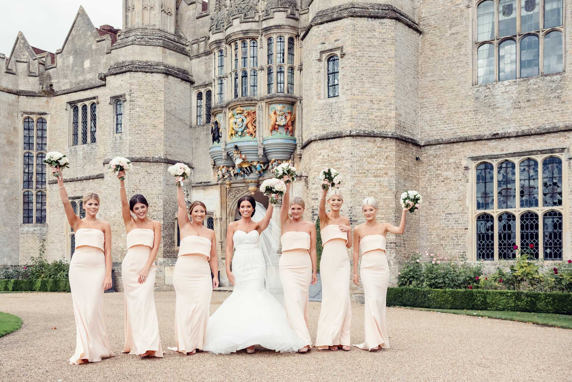The pastel colours of the bride and bridesmaids' bouquets look fabulous against the nude dresses.