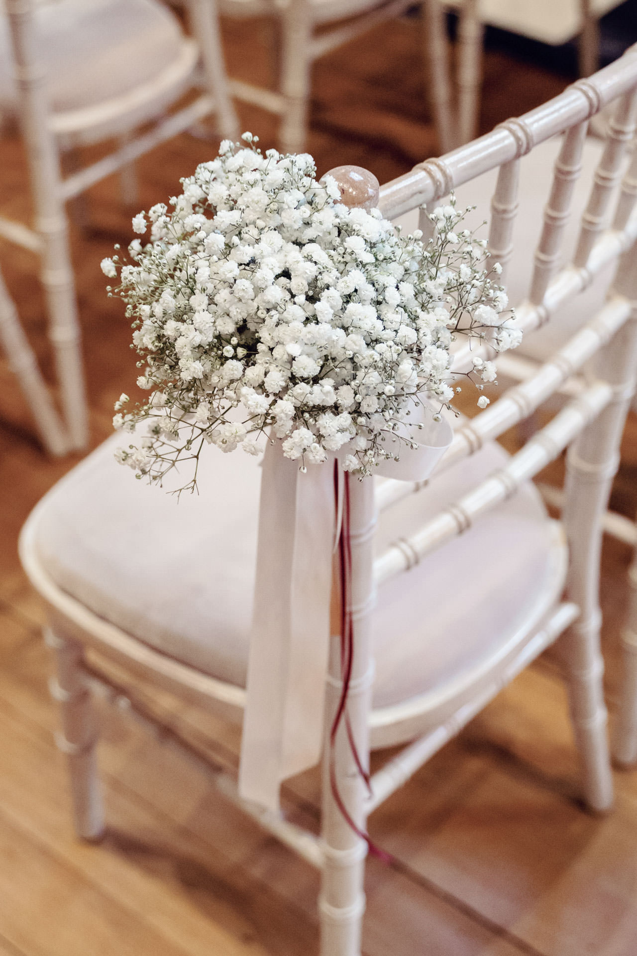 A simple posy of Gypsophila is a great choice to line the aisle.