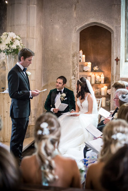 Beautiful posies set amongst ivory candles leading up the tower steps at Hengrave's chapel.