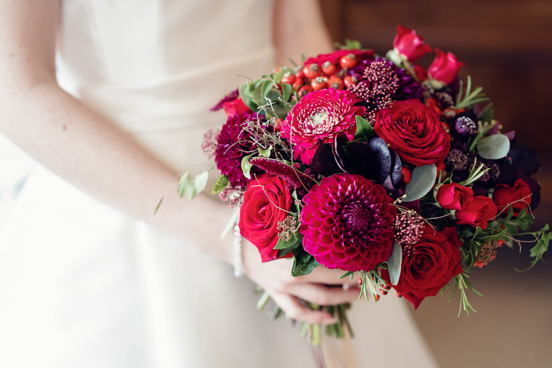 Deep crimsons and scarlets add real depth and drama to a bridal bouquet.