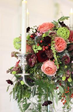 Autumnal Candelabra arrangement Thrive floristry