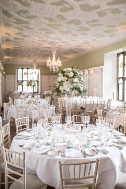 Simply exquisite tall table arrangements create drama and spectacle in Hengrave's Long Gallery.
