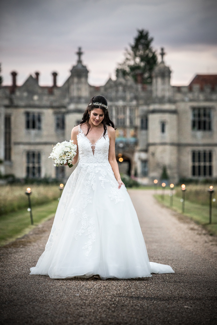 The beautiful lacework of Rachel's stunning dress echoes the gorgeous textures of the bouquet.