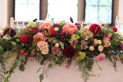 Autumnal top table arrangement Thrive floristry