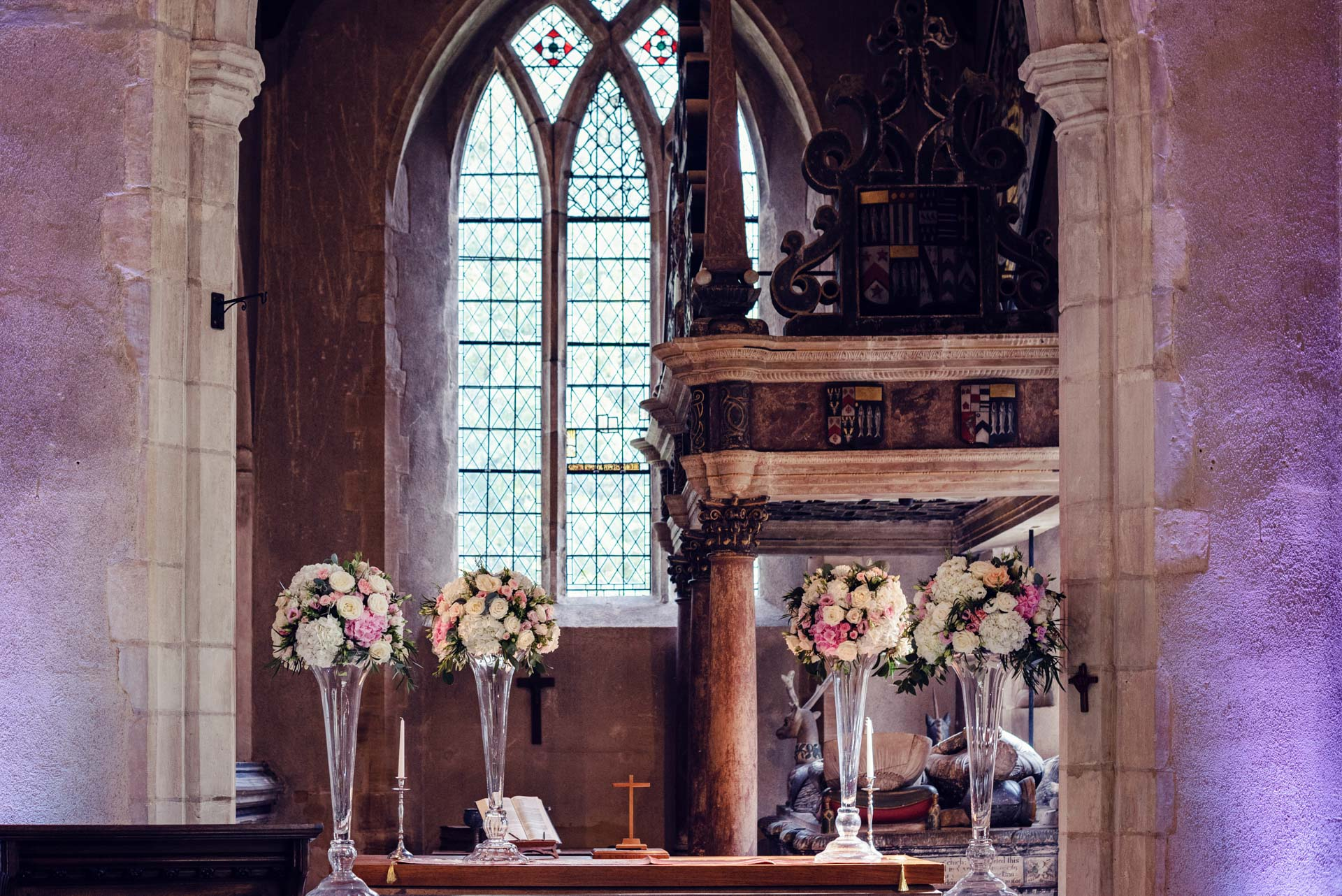 Tall table arrangements look positvely opulent in the chapel.