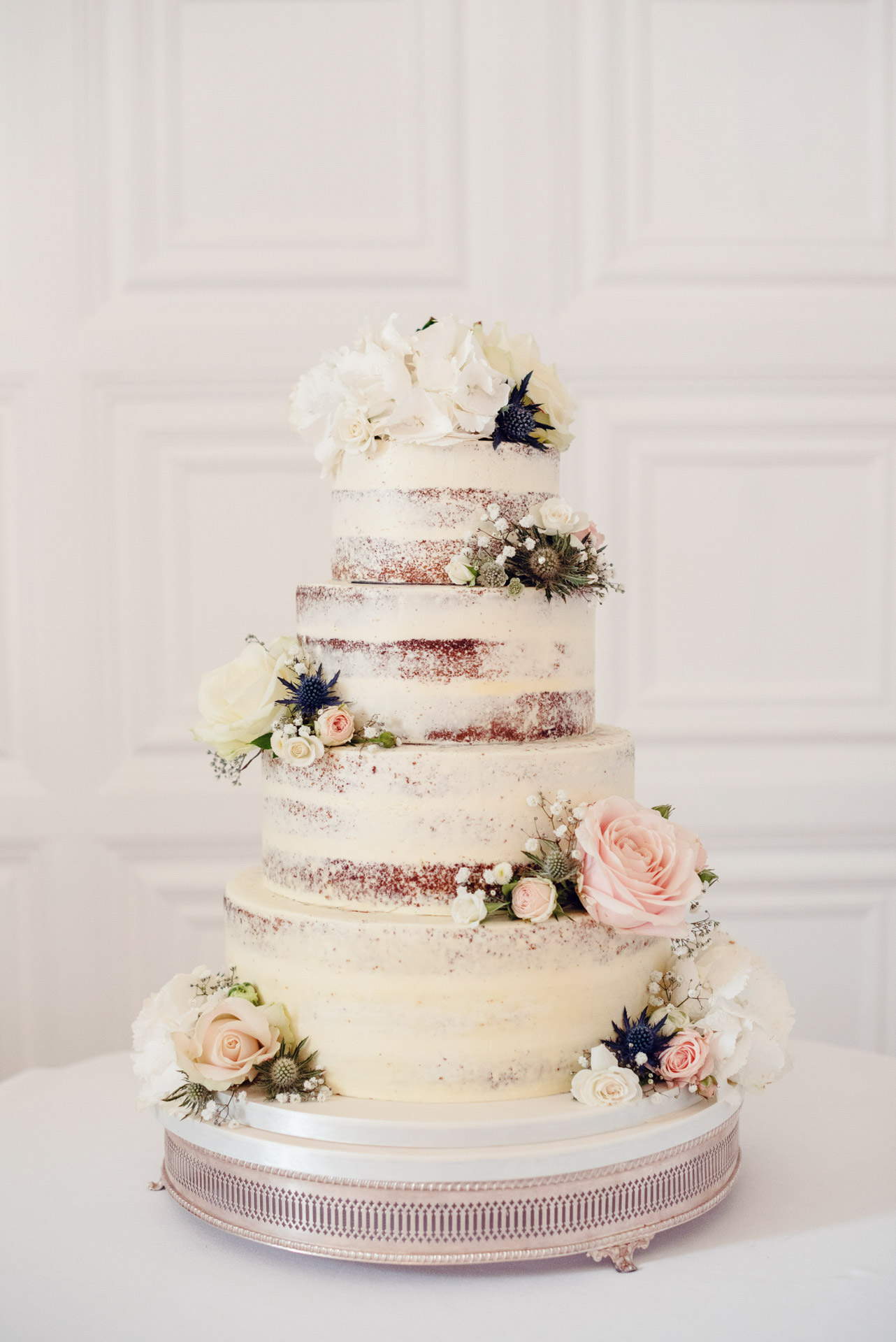 Semi naked cake, with floral clusters