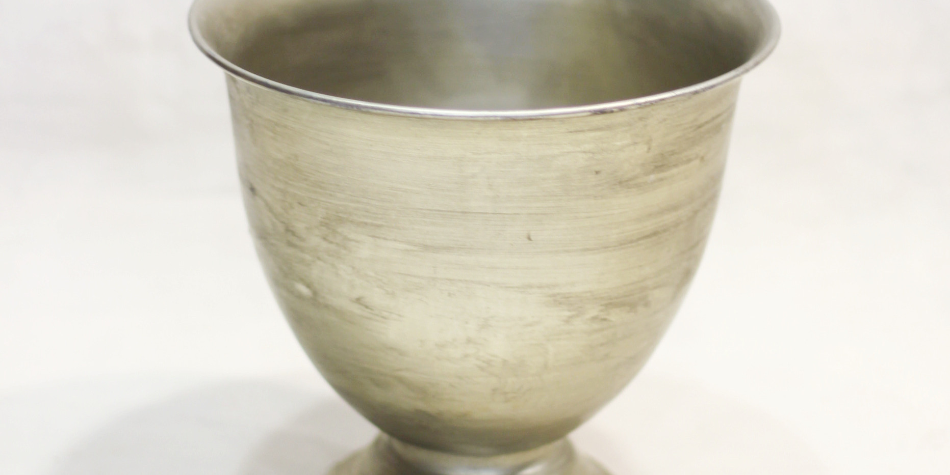 Champagne metal footed container