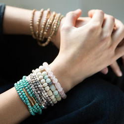 Display of bracelets on woman's arms