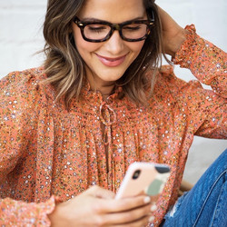 image of woman wearing fashionable reader glasses