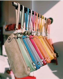 Display of colorful handbags