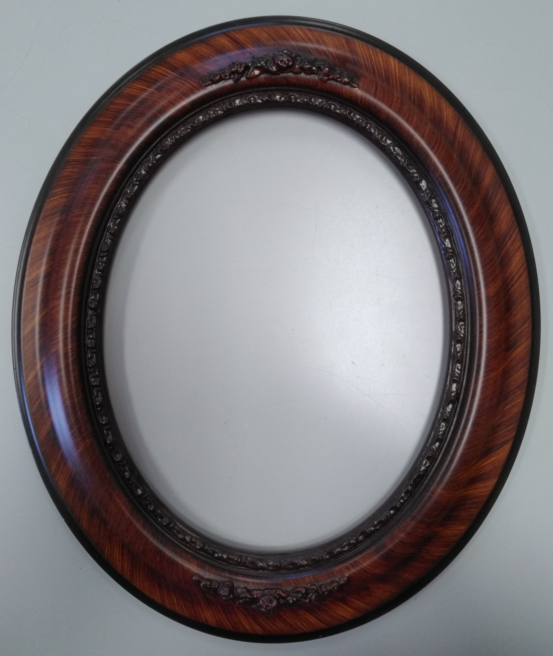 Oval Frames and Domed Glass
