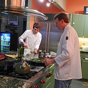 Chef Christopher Gage and Ryan Gage preparing lunch for a retreat