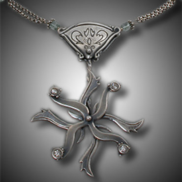 Kinetic Movement Pendant by Holly Gage
