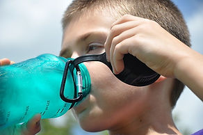 boy drinking from reusable water bottle