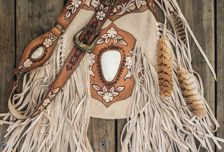 Apache Tasseled Bag ismade ofbuttery soft Italian Leatherin pale suedewith long, softly flowing suede tassels