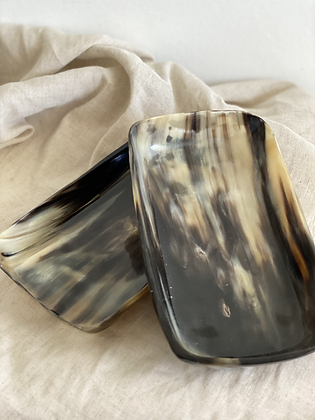 Handmade in Kenya from re-salvaged cow horn.