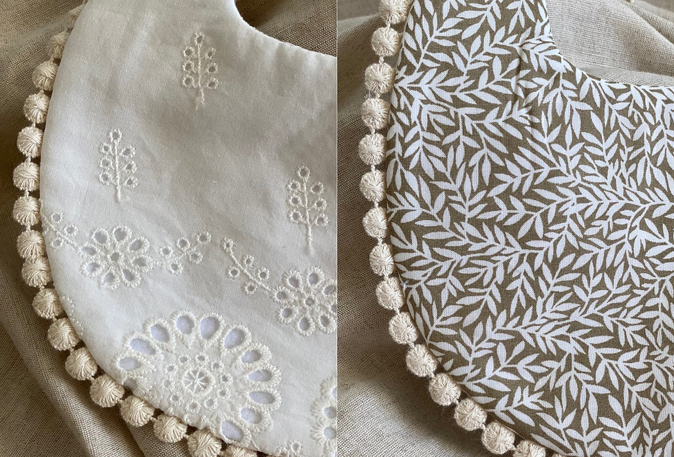 Reversible double sided baby bib featuring a lace anglaise side.