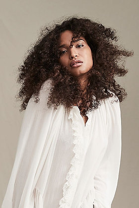 Jeanette Tunic Dress by Free People this romantic top is featured in a button-front style with ruffle