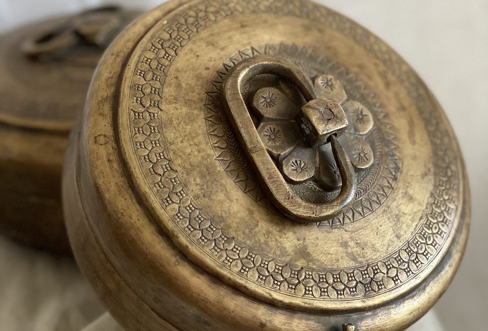 These small vintage brass chapati boxes are intricately decorated and beautifully aged