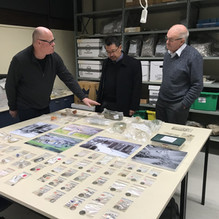 LCC Trustees Prof Richard Walter, Malcolm Wong and Peter Cummings at Otago University  looking at artefacts from the camp  in storage.