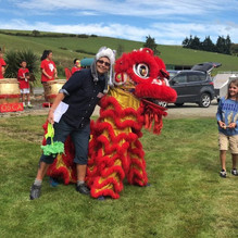 Adrienne Shaw,   descendant of Chow and Grace Tie, at Chinese New Year 2018  with lion dancers