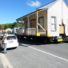 Joss House being relocated back to the camp  late 2016 from its site in Maryport Streeet where  it was used  as a holiday home.