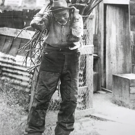 Miner retired; Jimmy Shin carrying firewood on his back.