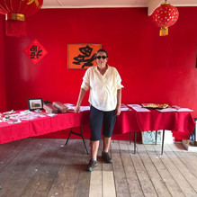 Adrienne in Joss House with display tables, March 2019