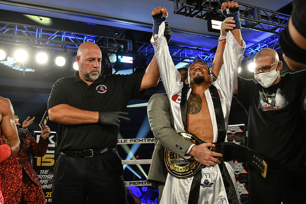 Luis Palomino has his hand raised in victory at BKFC 14 - Photo by Phil Lambert for Bare Knuckle FC