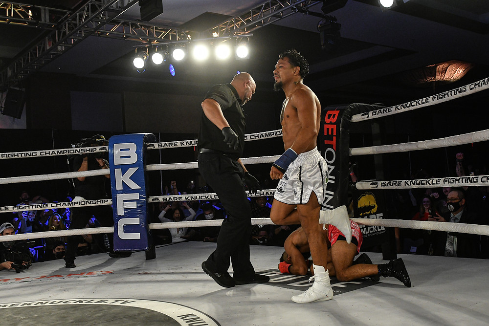 Luis Palomino drops Jim Alers in the first round at BKFC 14 - Photo by Phil Lambert for BKFC