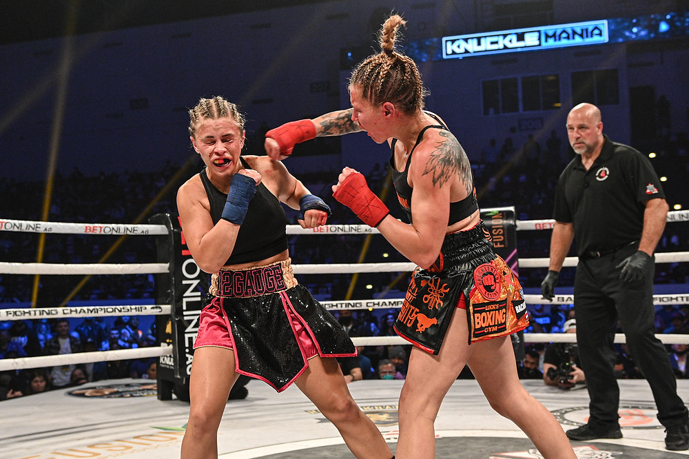 Britain Hart connects with Paige VanZant - Photo by Phil Lambert for BKFC
