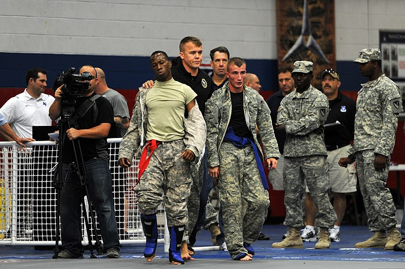 U.S. Army Spc. Larry Jackson, left, and Spc. Miles McDonald, with the Missouri Army National Guard, finish grappling in the semifinal rounds of the bantamweight division during the 2012 U.S. Army Combatives