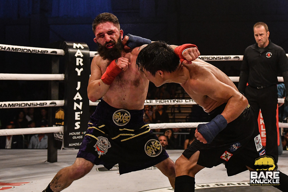 Dat Nguyen (right) and Travis Thompson (left) go to war at BKFC 8 - Photo by Phil Lambert for Bare Knuckle Fighting Championship