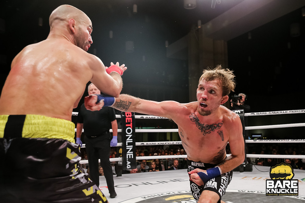 Jason Knights punches Artem Lobov in BKFC 9 rematch main event - Photo by Ryan Nixon