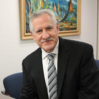 Dr. Carlos E. Santiago