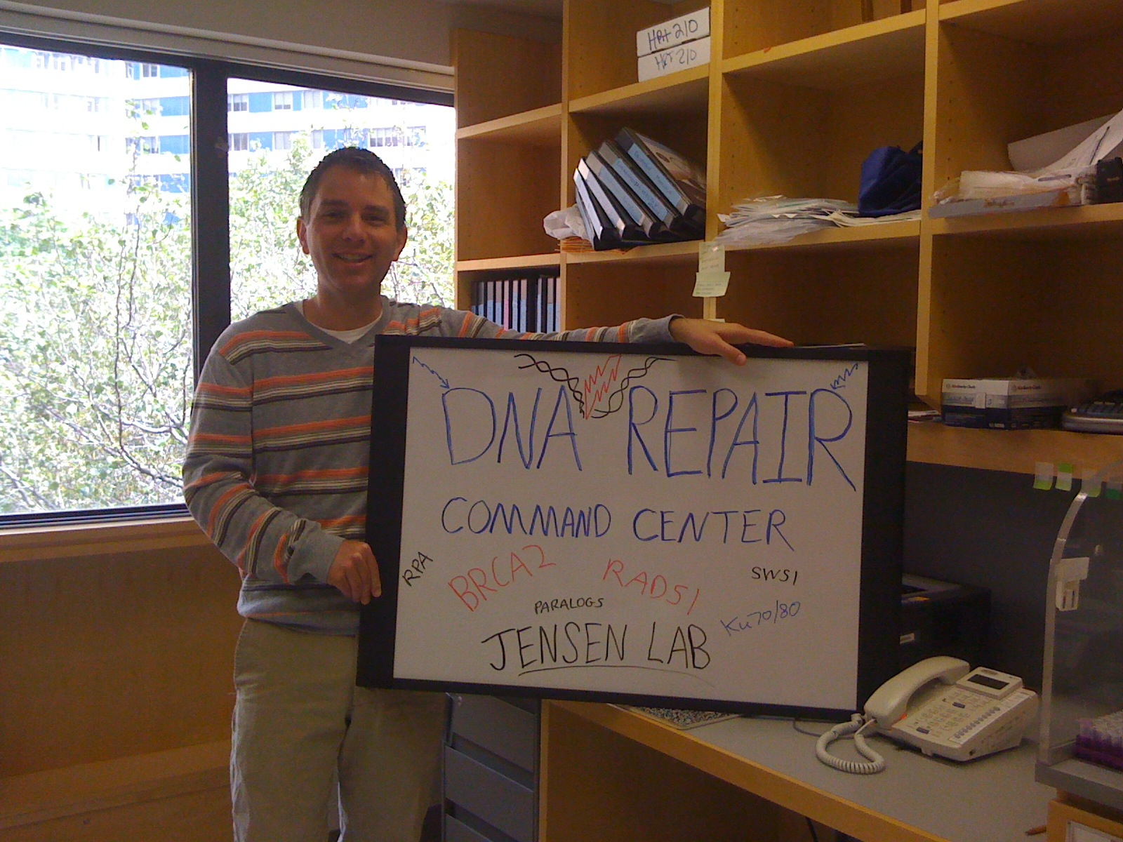 Ryan with DNA Repair sign in Hunter 210
