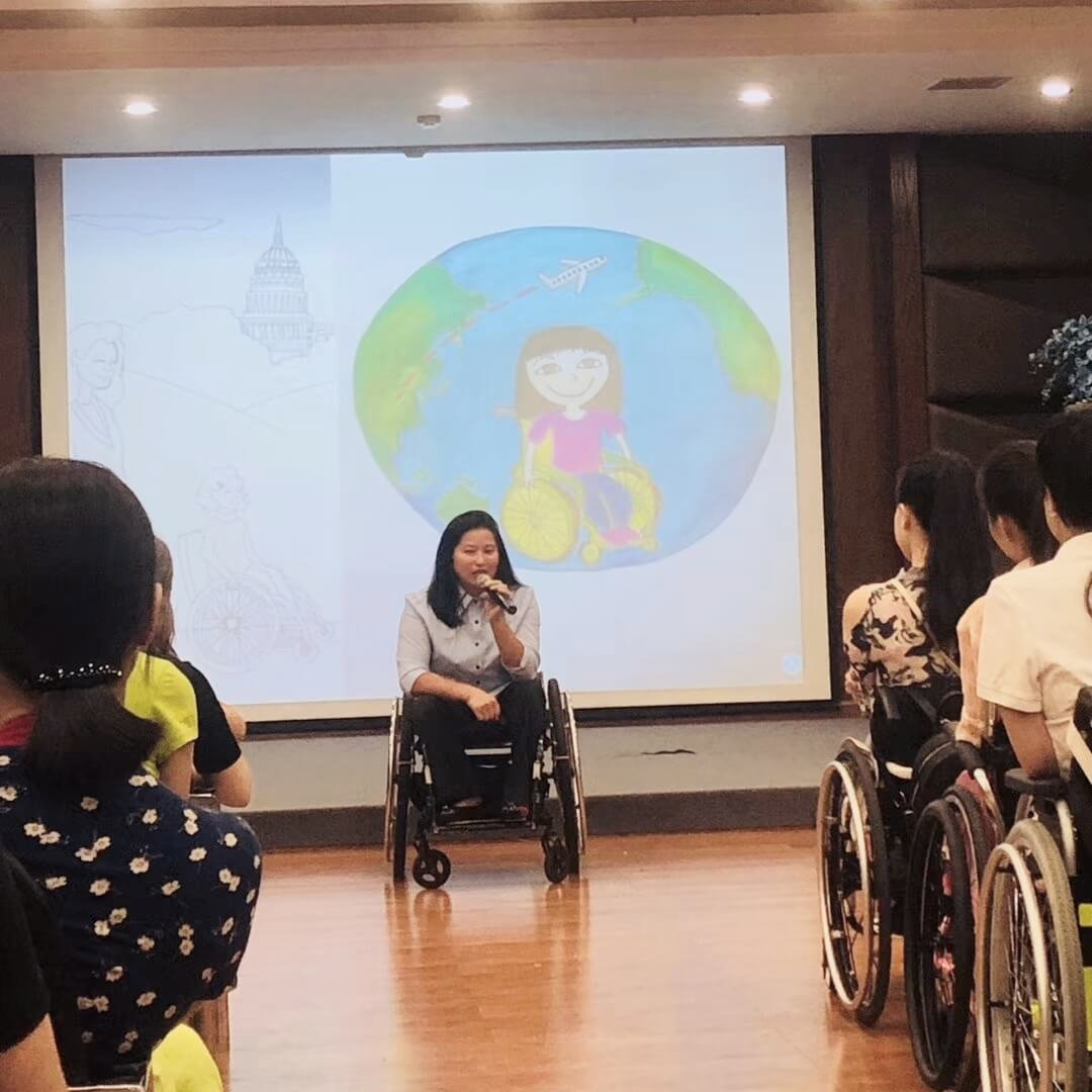 Ming gives a presentation on her work