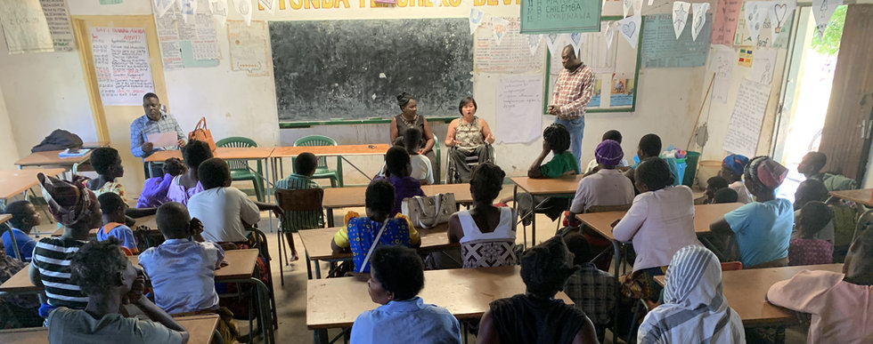 Ming presents at a classroom to both children and adults