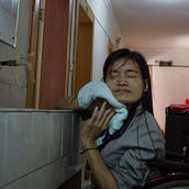 """China File's article, """"For Chinese Orphan with a Disability, Life in the U.S. Brought the Strength to Help a Friend Left Behind"""""""
