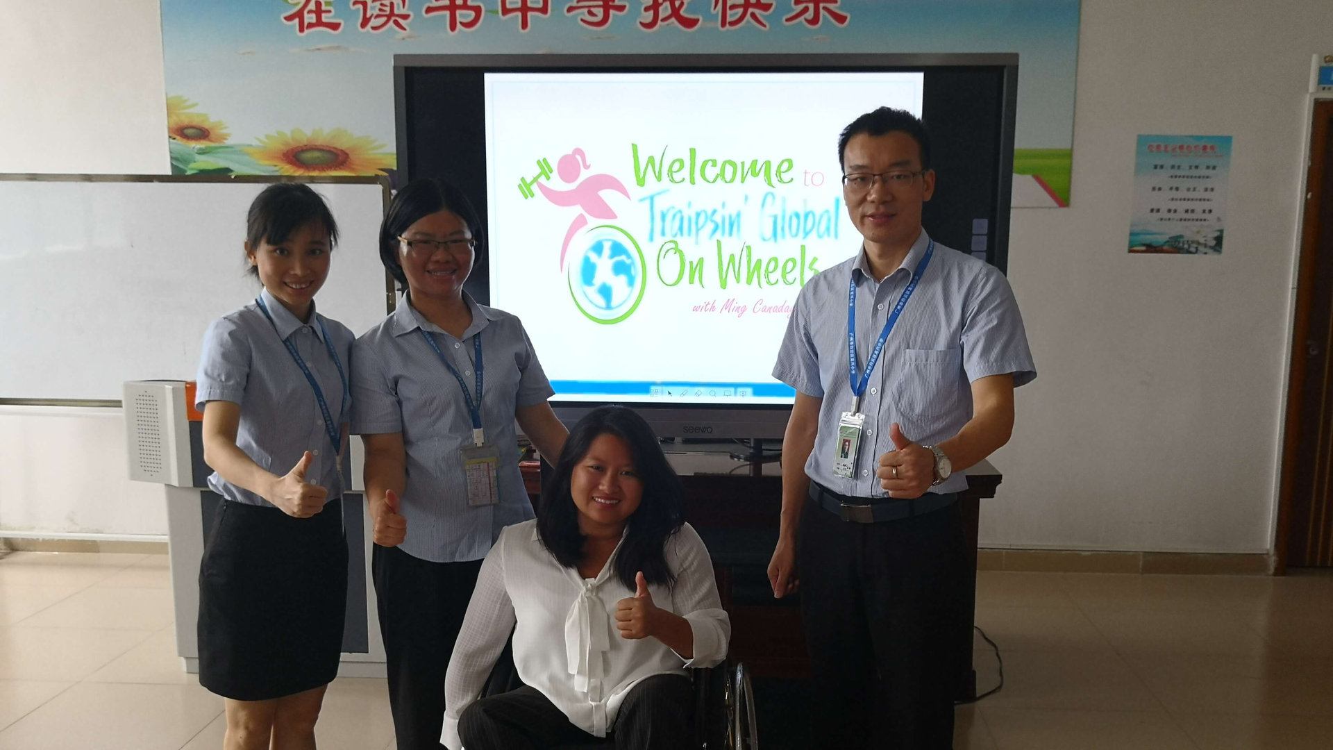 Ming and staffers giving thumbs up signs