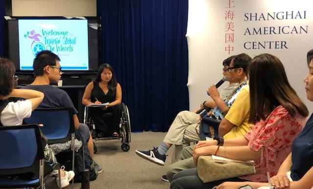 Ming listens to a question at the Shanghai American Center